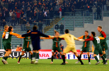 AS Roma players celebrate at the end of the Italian Cup soccer match against Juventus in Rome
