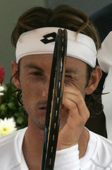 Juan Carlos Ferrero of Brazil adjusts his racket during his Brazil Open final tennis match against Guillermo Canas of Argentina at Costa do Sauipe in Bahia