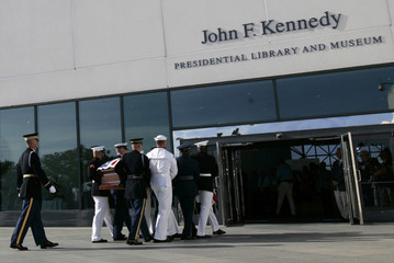 The casket of U.S. Senator Edward Kennedy is carried by a United States military honor guard into John F. Kennedy Library and Presidential Museum in Boston