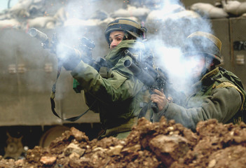 ISRAELI SOLDIERS FIRE TEARGAS AT PALESTINIAN DEMONSTRATORS AFTER THEFRIDAY PRAYERS IN THE WEST BANK ...