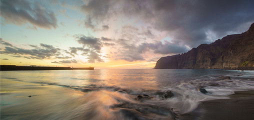 Dynamic and dramatic sunset over Los Gigantes Cliffs in Tenerife