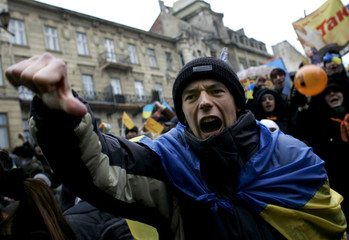 A young man shouts anti government slogans during a demonstration in the centre of Lviv.