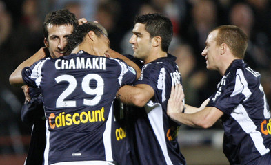Bordeaux players celebrate after their team scored against Paris Saint Germain during their French Ligue 1 soccer match in Bordeaux