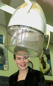 BELGIAN PRINCESS MATHILDE STANDS BEHING A HAIRDRYER DURING A VISIT TO THE ENSOR INSTITUT IN OSTEND.