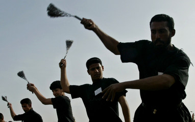 IRAQI SHI'ITE MEN BEAT THER BACKS WITH METAL CHAINS IN BAGHDAD.