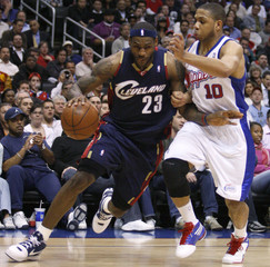 Cleveland Cavaliers LeBron James drives past Los Angeles Clippers Eric Gordon during their NBA basketball game in Los Angeles