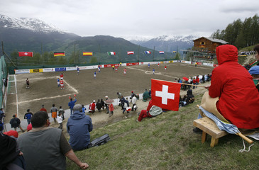 A Swiss supporter watches match at Euro of Mountain Villages soccer tournament in Gspon in Swiss Alps