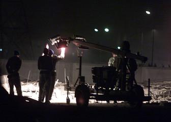 PAKISTANI SOLDIERS STAND GUARD AT BLAST SCENE IN RAWALPINDI.