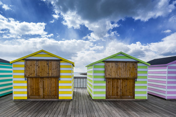 Hastings pier and beach huts in the county of Sussex