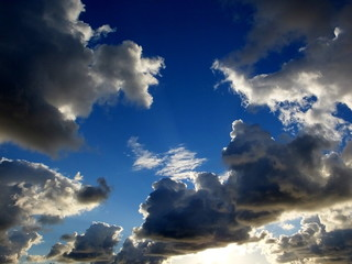 Blue sky with white, gray and silver clouds