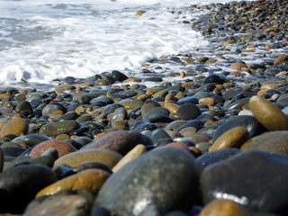 Closeup of smooth stones at shore