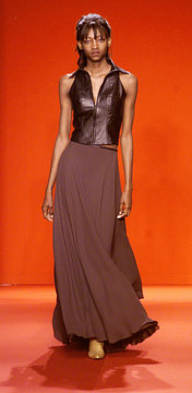 MODEL IN LEATHER VEST AT DOUGLAS HANNANT FASHION SHOW.