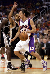 Phoenix Suns Steve Nash tripped by San Antonio Spurs Tony Parker in Game 1 of Western Conference finals.