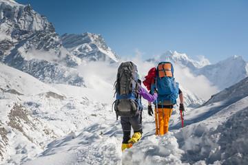 Fototapeta Trekkers crossing Gokyo glacier in Khumbu valley on a way to Everest Base camp obraz