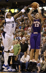 Suns Nash shoots over Mavericks Terry during overtime period in Game Six of conference semi-finals in Dallas.