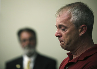 Family member of 911 victim chokes up during news conference at Camp Justice