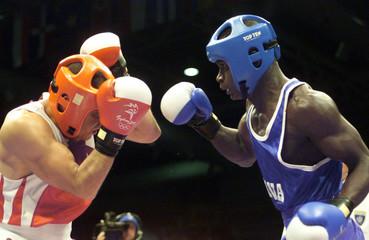 ALGERIA'S ALLALOU FIGHTS GHANA'S NEEQUAYE IN 63.5 KG OLYMPIC MATCH.