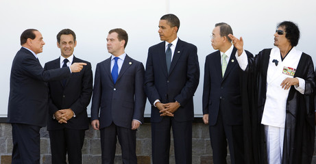 Italy's PM Berlusconi, France's President Sarkozy, Russia's President Medvedev, U.S. President Obama, U.N. Secretary-General Ban and Libya's leader Gaddafi stand during a family photo at the G8 summit in L'Aquila