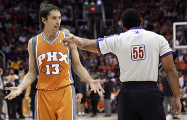 NBA official Kennedy signals Phoenix Suns Nash to the team's bench as Nash argues the decision during first quarter NBA basketball action against the Los Angeles Lakers in Phoenix