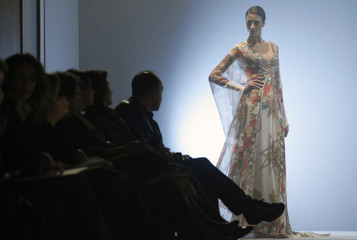 A model displays a creation by Syrian designer Rami Al Ali during his Rome Fashion Week Haute Couture Spring/Summer 2009 show