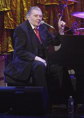 Jerry Lee Lewis performs during an event at the Apollo Theater for the Clinton Global Initiative, in the Harlem neighborhood of New York