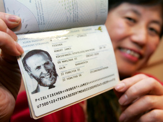 Miyoko Watai, former world chess champion Bobby Fischer's fiancee, shows off his passport in Tokyo.