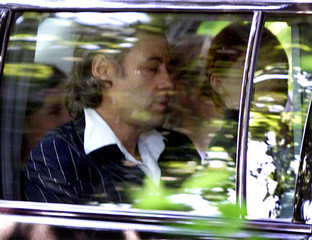 A sombre Bob Geldof is driven away from the funeral of his former wife, television personality Paula..