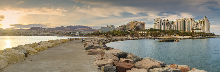 View on Eilat city from walking stone pier. Eilat is the southernmost port and famous resort and recreational city in Israel and the Middle East