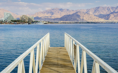 Footpath and view the Red Sea at central beach of Eilat - famous resort and recreational city in Israel