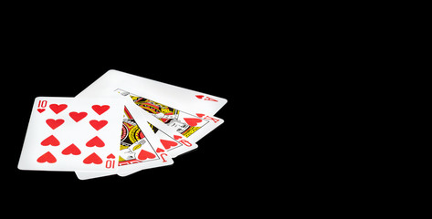 Playing cards on a black background.