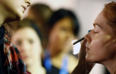 A model has make-up applied before Krystof Strozyna's Autumn/Winter 2008 show at London Fashion Week