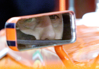 GERMAN FORMULA ONE DRIVER MICHAEL SCHUMACHER LOOKS IN HIS REAR VIEW MIRROR DURING THE FIRST FREE ...