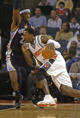 Memphis Grizzlies' Warrick blocks the path of Bobcats' Wallace during NBA game in Charlotte
