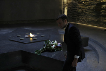 Emmanuel Macron, head of the political movement En Marche !, or Onwards !, and candidate for the 2017 presidential election, visits the Shoah Memorial in Paris
