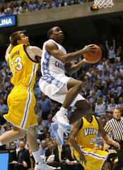 The University of North Carolina's Ty Lawson drives to the basket against Valparaiso's Samuel Haanpaa and Jarryd Loyd during the first half of their NCAA basketball game in Chapel Hill