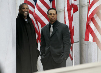 Actor Denzel Washington and golfer Tiger Woods watch offstage during the We Are One: Opening Inaugural Celebration in Washington