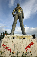 Flowers are placed in front of a 12-metre-high statue of late pop icon Michael Jackson in Regensdorf near Zurich