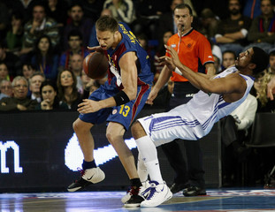 Barcelona's Andersen goes to the basket as Real Madrid's Massey tries to block during their Euroleague basketball game in Barcelona