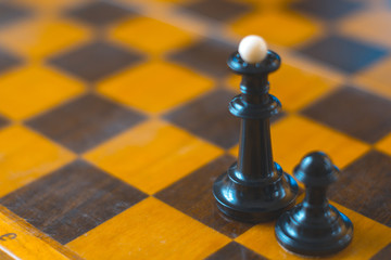 Chess pieces on the chess board concept politics.