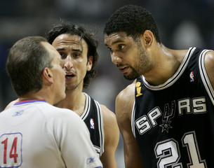 Spurs Ginobili and Duncan argue a call with a referee at left during first half play of Game 4 of the ...