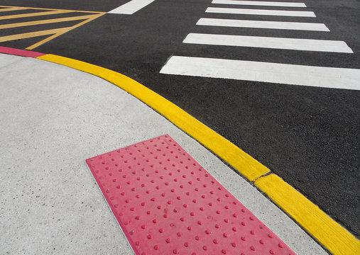 painted curb and crosswalk markings