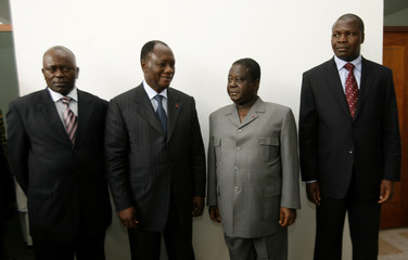 Ivorian leaders pose for photographers as they arrive for a meeting in Cocody, Abidjan