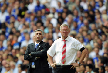 Chelsea's Anceloti and Manchester United's Ferguson watch their English Community Shield soccer match in London