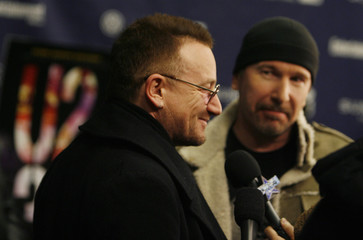"""Bono and The Edge of U2 are interviewed at premiere of """"U2 3D"""" at the 2008 Sundance Film Festival in Park City"""