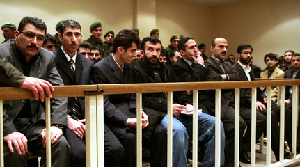 The defendants sit in the dock at a court in Istanbul.