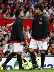 Manchester United twins Fabio and Rafael Da Silva warm up during pre-season friendly against Juventus in Manchester