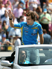 Formula One world champion Alonso of Spain greets crowd during roadshow in Seville