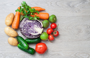 A crop of fresh vegetables on a wooden table. The concept of farming.