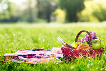 Fotobehang picnic basket and blanket outdoors
