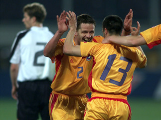 ROMANIA'S STOICANCONGRATULATES CARAMARIN DURING FRIENDLY SOCCER GAME AGAINST GERMANY.
